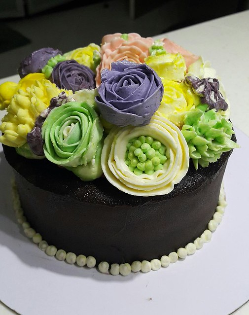 Floral Cake by Frostings & Glazes Cupcakes