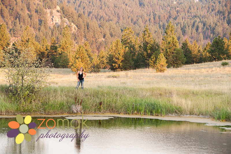high school senior in helena montana with reflection in pond