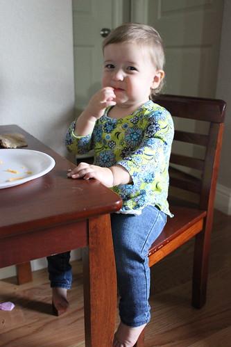 Dakota eating at craft table
