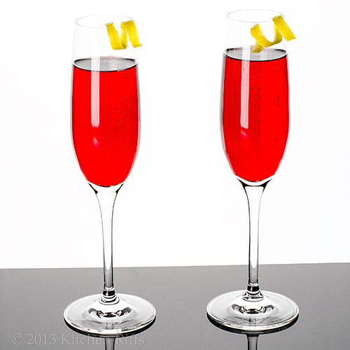 Kir Royale Cocktails with lemon twist garnish