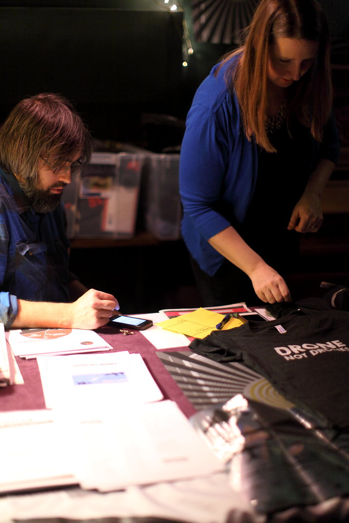 Luke and Jessica at the merch table