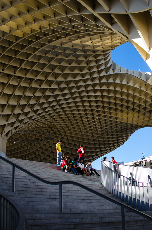 A group of students enjoy a picnic breakfast on the steps of Las Setas in Sevilla.