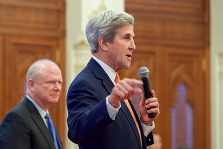 Ambassador Marc Sievers Stands With Secretary Kerry as he Addresses Staffers Working at the U.S. Embassy Muscat