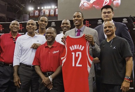 July 13, 2013 - Dwight Howard poses at his press conference with former Rocket players, including Yao Ming
