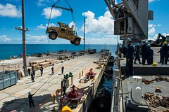 Marine vehicles attached to the 31st Marine Expeditionary Unit are offloaded from USS Germantown (LSD 42) in Okinawa, Sept. 11. (U.S. Navy photo by Mass Communication Specialist 2nd Class Andrew B. Church)