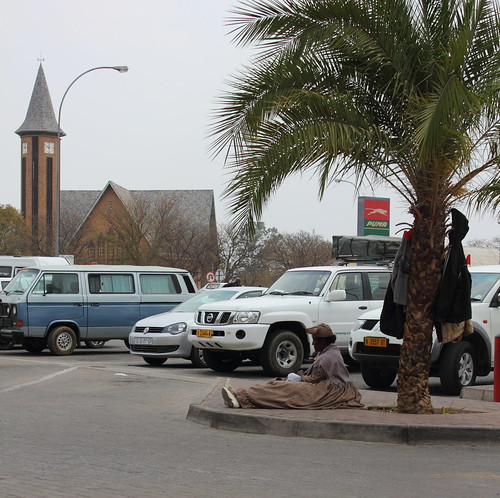 Herero woman sitting in the car park