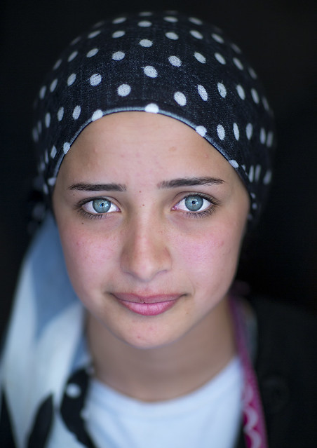 Closeup Portrait Of A: Close-up Of A Young Syrian Refugee Face With Blue Eyes