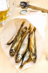 Mug of beer with smoked fish