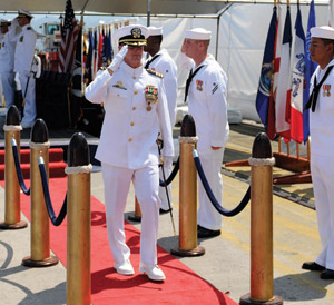 Cmdr. Thomas E. Shultz, outgoing commanding officer of USS Michael Murphy (DDG 112), walks through sideboys at the conclusion of a change of command ceremony May 23. Cmdr. Corey J. Turner relieved Shultz as commanding officer during the ceremony.