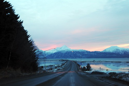Entering onto the Homer Spit, open road, winter, Katchemak Bay, snowy mountains, pink twilight, Homer, Alaska, USA by Wonderlane