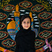 Portrait of an iranian shiite muslim girl in front of a Muharram flag, Isfahan, Iran by Eric Lafforgue