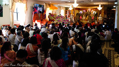 Buddhists facing the altars