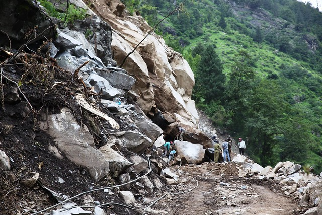 A massive landslide on the road in Pandukeswar, 21 km from Joshimath town. Thousands of roads, buildings and bridges in the northern Himalayan state of Uttarakhand have been destroyed by the floods and landslides, caused by heavy rains, on June 16 and 17. Credit: Nita Bhalla/Thomson Reuters Foundation.