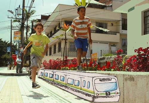 kids playing on a mural of the Medellin Metro (by: Plan Estratégico Habitacional de Medellín, creative commons)