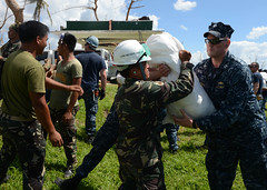 USS Mustin (DDG 89) Sailors work with members of the Armed Forces of the Philippines to transport relief supplies in Ormoc City during Operation Damayan. (U.S. Navy photo by Mass Communication Specialist 3rd Class Mackenzie P. Adams)