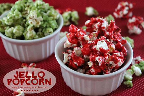Jello Popcorn in red and green in two white bowls.