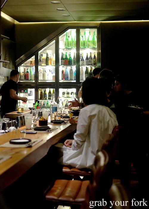 Diners sitting at the bar at Ronin, Hong Kong