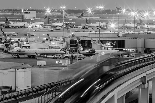 sunset blackandwhite bw usa motion monochrome tarmac digital train airplane photography us photo airport movement texas photographer unitedstates image fav50 tx united unitedstatesofamerica airplanes houston tram tags fav20 f16 photograph le 400 transportation planes bluehour february fav30 iah unitedairlines fineartphotography 2014 200mm architecturalphotography commercialphotography fav10 25sec bushintercontinental fav40 architecturephotography ef200mmf28liiusm intercontinentalairport houstonphotographer mabrycampbell february62014 terminalab longexpusire 20140206h6a9386