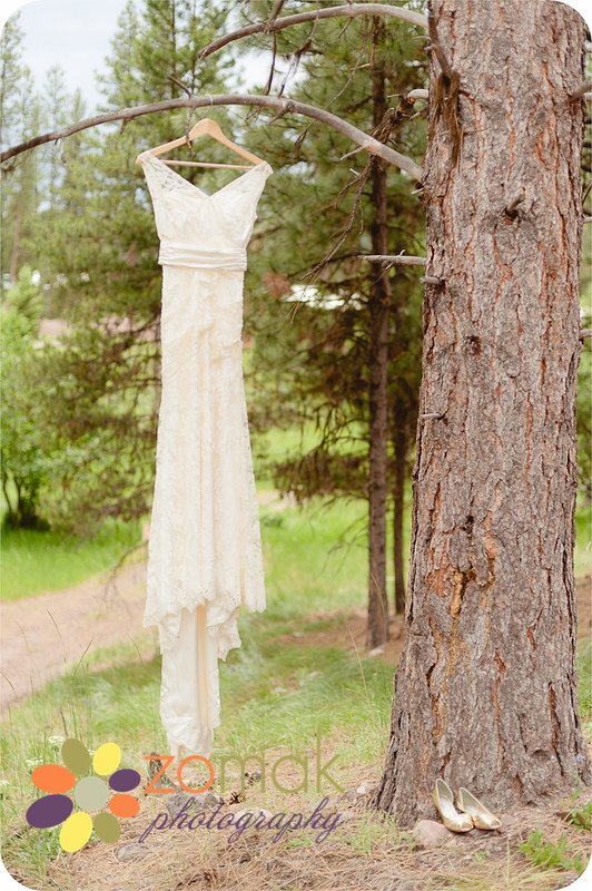 The bride's dress hangs gracefully from a pine tree near Seeley Lake, Montana