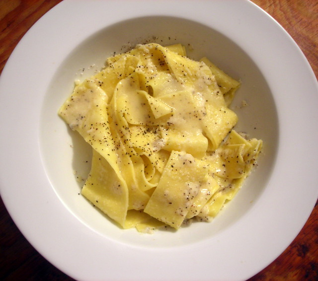 "Pappardelle con cacio e pepe (""pappardelle with cheese and pepper"")"