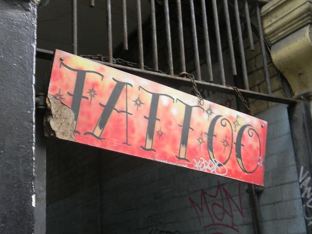 Grafitti tattoo sign denmark street bloomsbury sign london for 15th street tattoo