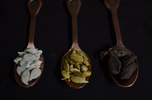 The cardamom pod lineup: white, green and black/brown
