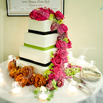 Cascading roses and  orchids for wedding cake
