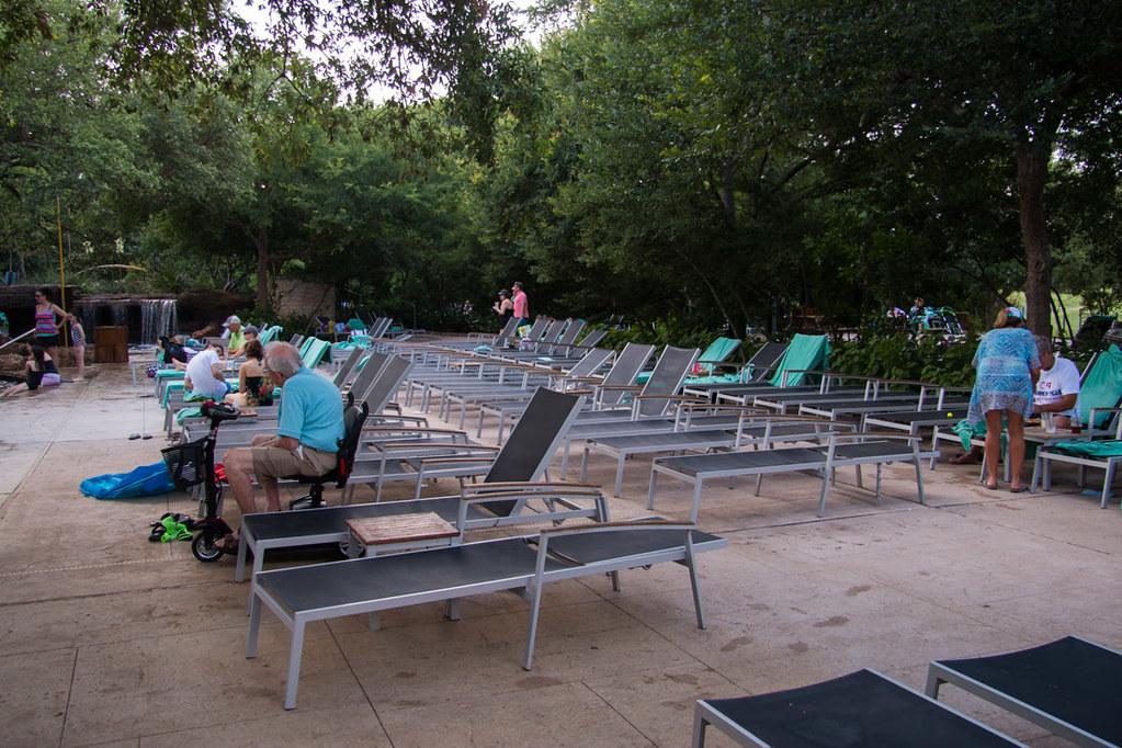 Lounge chairs near pool