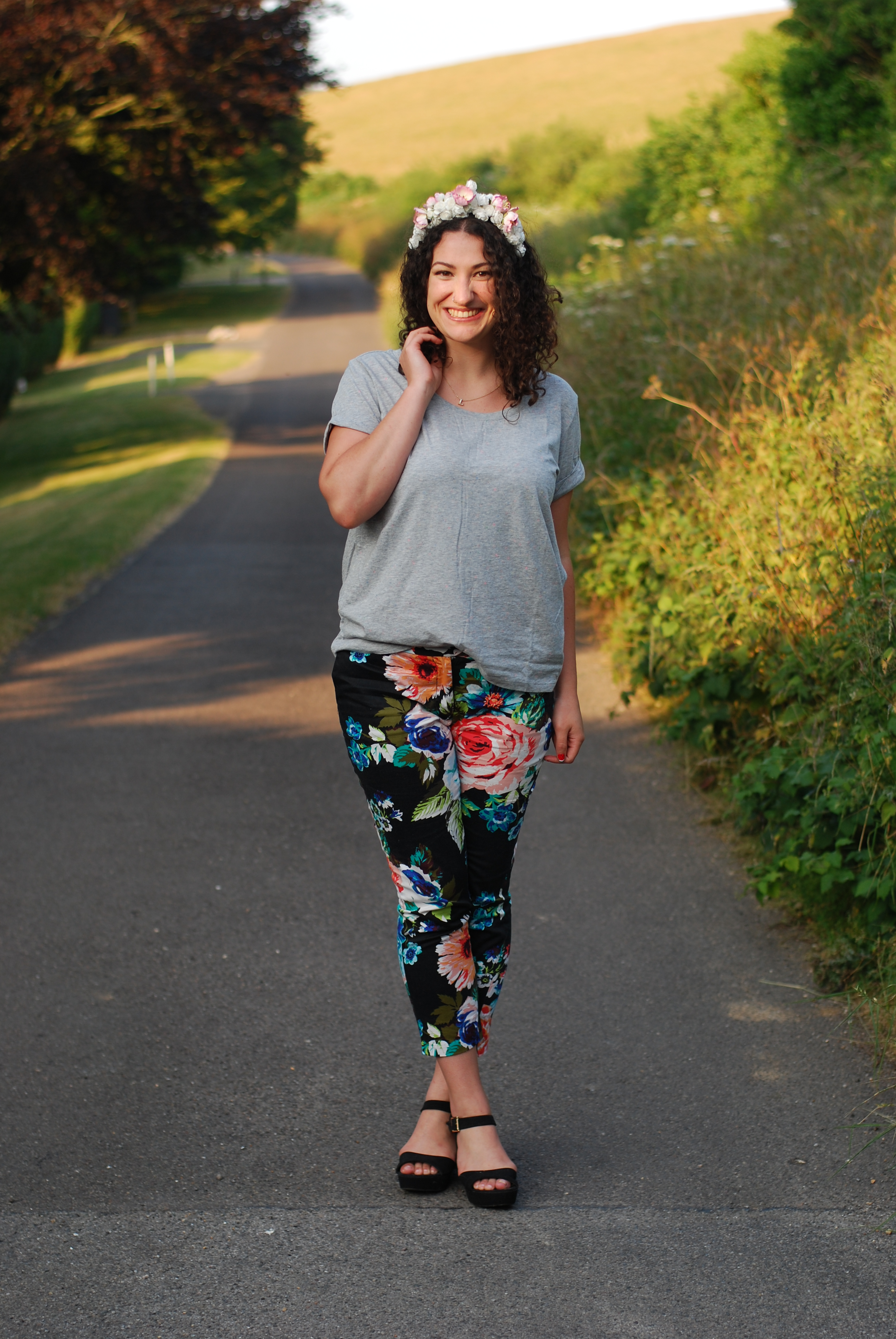 chambray and curls curly hair floral trousers countryside