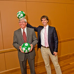 13-034 -- Author Warren St. John hams up a photo op with President Wilson. Both were presented with soccer balls signed by members of the IWU soccer teams following the President's Convocation, where St. John spoke about his book, Outcasts United.