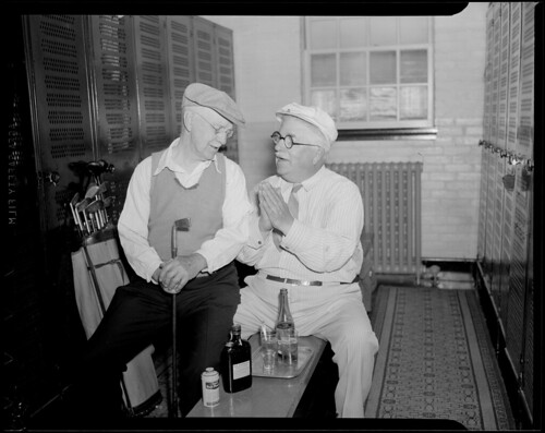 Old duffers drinking whiskey in the locker room at the Woodland Golf Club