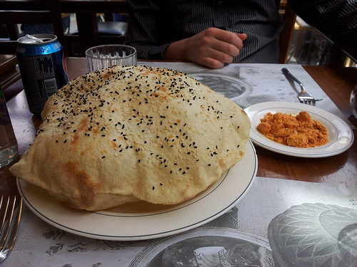 Puffed flat bread served with a roasted red pepper spread at Çiya Kebap