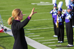 Dr. Mallory Thompson Conducts the University Hymn ::  	   The Northwestern University 'Wildcat' Marching Band rehearses outside Ryan Field just before Northwestern Wildcat Football competes against Western Michigan University on September 14, 2013.  Photo by Daniel M. Reck (GSESP08).