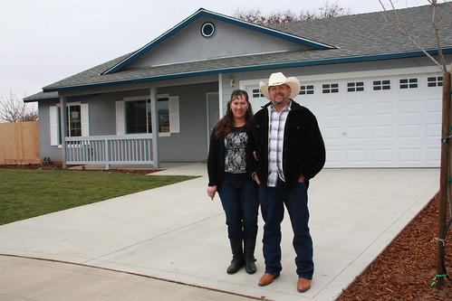 Maria and Ignacio Gordillo stand before their new home in Reedley, Calif. Along with 10 other families, the Gordillos helped build their house through USDA's Mutual Self-Help Housing Loan program in partnership with Self-Help Enterprises. (USDA photo)