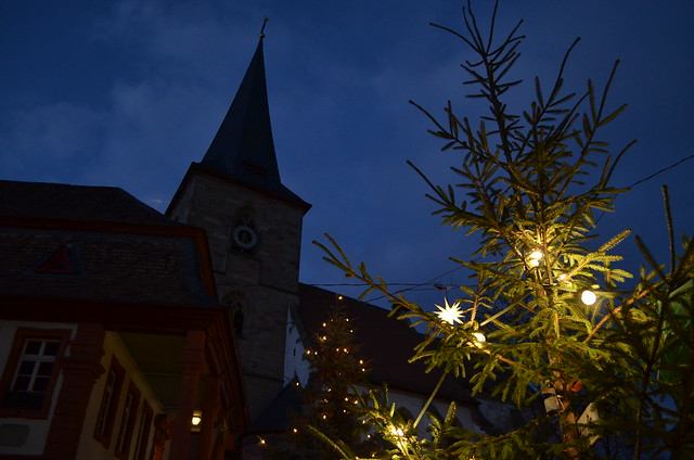 Weihnachtsmarkt Freinsheim church and lit Christmas tree at night