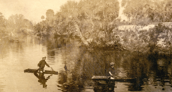 Koreshan boys rowing on the Estero River, Florida