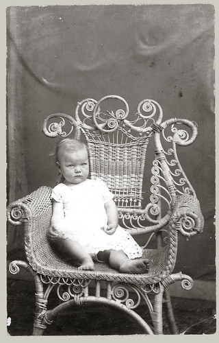 Baby in wicker chair