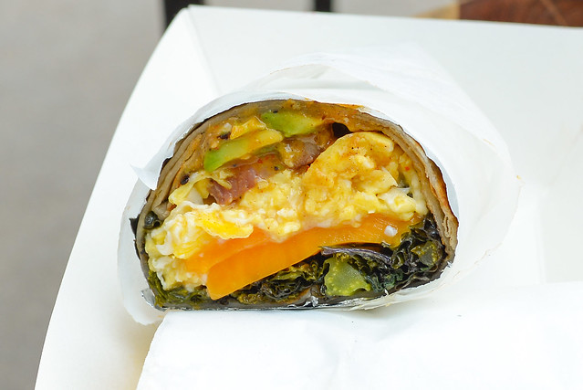 Neuske's Bacon Burrito scrambled eggs, charred kale, cheddar, avocado, arbol chile