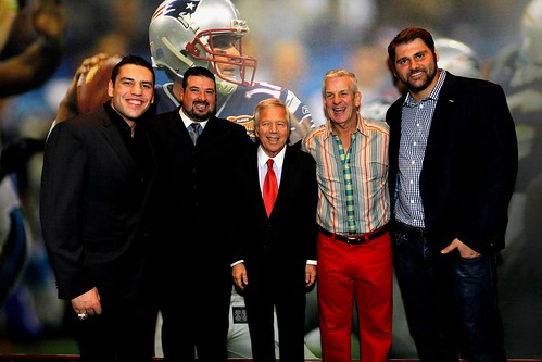 Foxborough, MA - From left Boston Bruins forward Milan Lucic, former New England Patriot Joe Andruzzi, New England Patriots owner Robert Kraft, actor and comedian Lenny Clarke, and New England Patriots offensive lineman Sebastian Volmer pose for a photo a