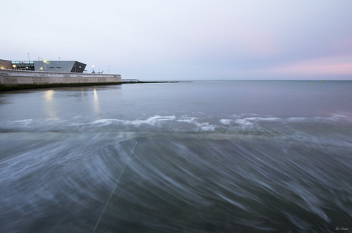 blue sea building green water wales sunrise waves le