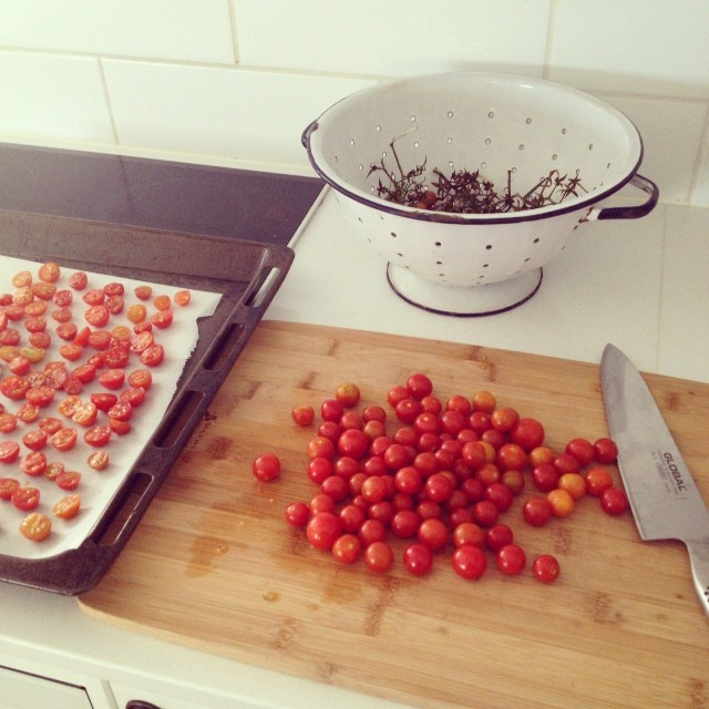 Yesterday's harvest is becoming 'sun-dried' tomatoes in olive oil. My pregnancy food addiction... #nomnomnom #preserving #cherrytomatoes #organic