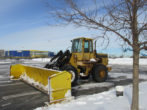 A front end loader tractor equipped with an extra wide snowplow attatchment.  Schaumburg Illinois.  Wednsday, January 8th, 2013. by Eddie from Chicago