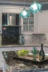 Uneek Lg. pendants above kitchen island