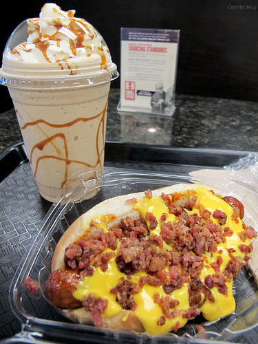 Andouille spicy sausage with bacon, cheese, & chili, and caramel coffee shake by Coyoty