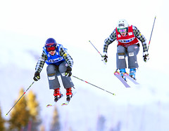 Kelsey Serwa and Georgia Simmerling battle it out in the quarter-finals at the FIS Ski Cross World Cup in Nakiska, CAN