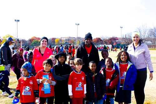 FNS Team members Kristin Caulley and Ileana Alamo (left to right) pose with one of the youth soccer leagues.