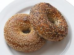 rye bread(0.0), whole grain(0.0), brown bread(0.0), bread(1.0), baked goods(1.0), produce(1.0), food(1.0), dish(1.0), bagel(1.0),