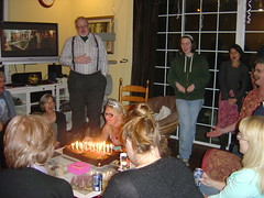 Everyone sings Happy Birthday to Shawn as she is about to blow out the candles