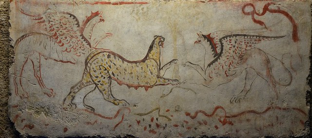 Painted travertine slab showing two griffins attacking a panther, 340 BC, found in tomb 58 at Andriuolo, Paestum, Monsters. Fantastic Creatures of Fear and Myth Exhibition, Palazzo Massimo alle Terme, Rome
