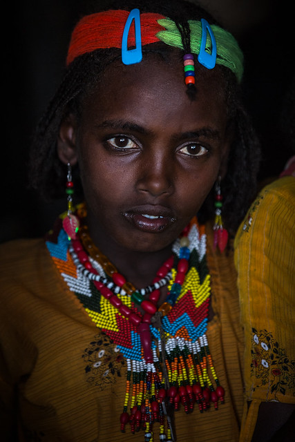 Oromo beautiful girl with colorful necklaces near asebe Teferi